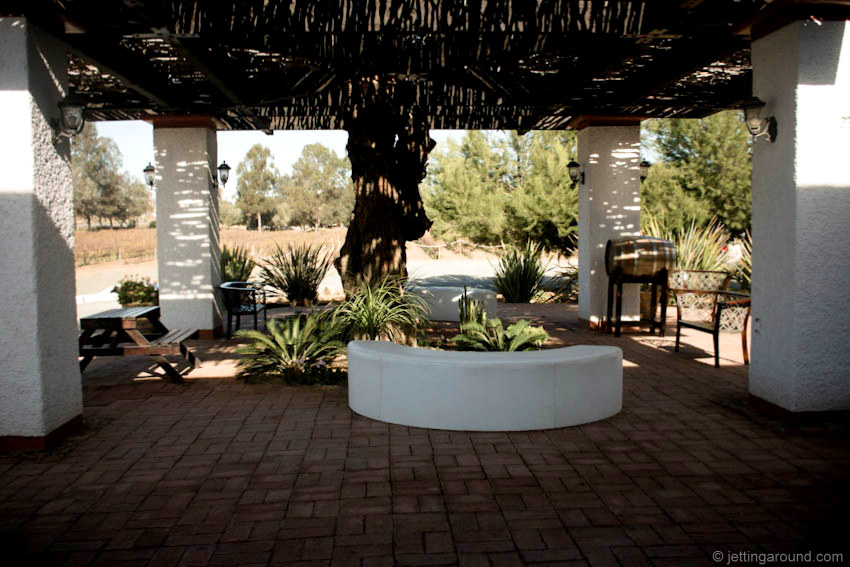 You can enjoy wine and views of the property from the shaded patio