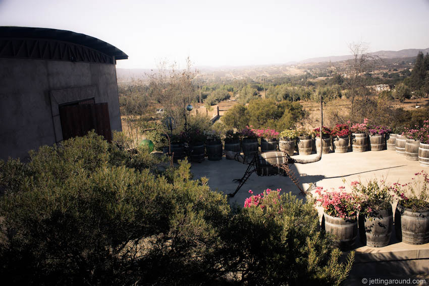 View of the valley from the tasting room. The spider made of metal parts and a wine barrel is a nod to the region's natural history.